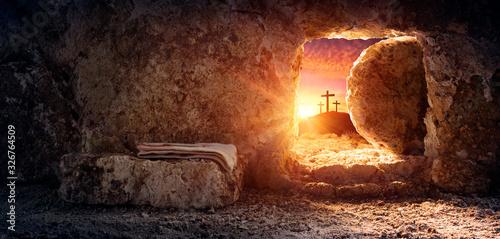 Stampa su Tela Tomb Empty With Shroud And Crucifixion At Sunrise - Resurrection Of Jesus Christ