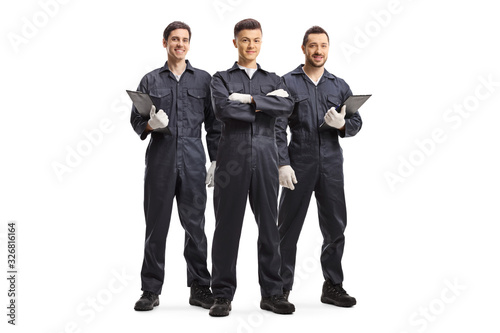 Canvas Print Three mechanic workers in uniforms