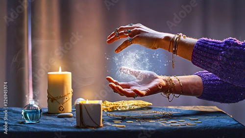 Fotografie, Obraz Magical luminous swirling glowing ball in the palm of a witch wizard woman during a witchcraft and occult esoteric spiritual ritual