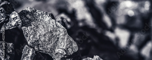 Canvas Print Coal miner in the man hands of coal background. Coal mining
