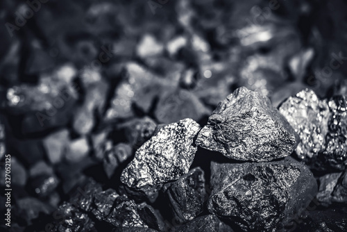 Foto Coal miner in the man hands of coal background. Coal mining