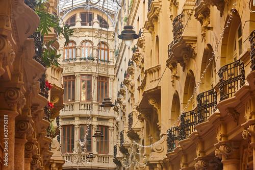Classic antique buildings facades passageway in Albacete. Spain