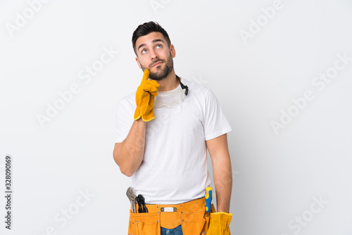 Craftsmen or electrician man over isolated white background thinking an idea