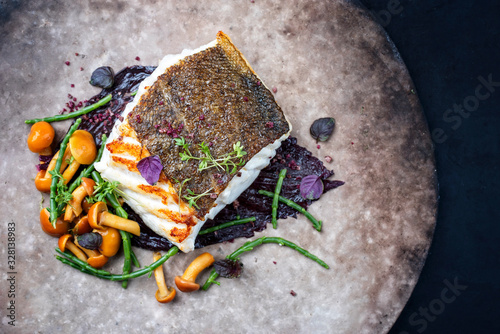Tablou Canvas Gourmet fried European skrei cod fish filet with glasswort, fungi and algae as t