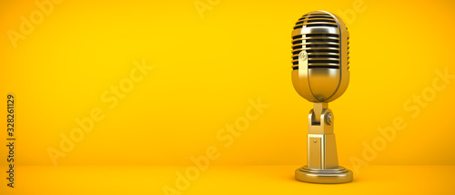 Foto gold microphone on yellow background