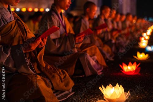 Monks praying at night on Vesak day for celebrating Buddha's birthday in Eastern Fototapeta
