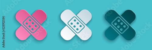 Paper cut Crossed bandage plaster icon isolated on blue background Fototapet
