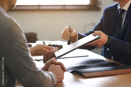 Photographie Male lawyer working with clients in office, closeup