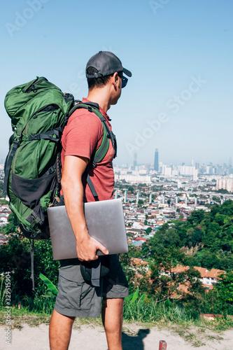 Fototapeta Digital nomad man traveling the world working