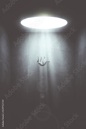 Photo man falling in the void from big hole, surreal concept