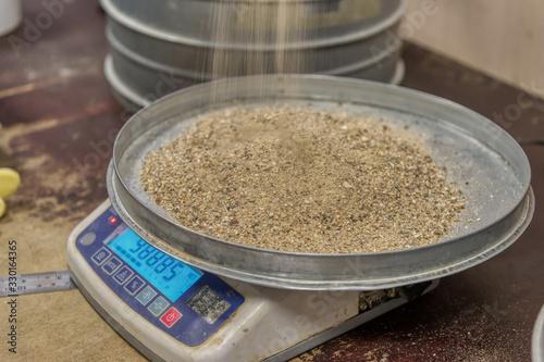 Obraz na plátně Sand tray on a laboratory balance.