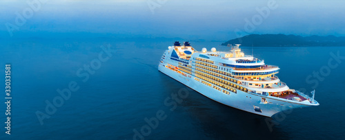 Obraz na plátně Aerial view of beautiful white cruise ship above luxury cruise in the ocean sea at early in the morning time concept smart tourism travel on holiday take a vacation time on summer