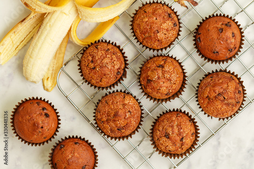 Stampa su Tela Homemade banana muffins with chocolate chips and salted caramel on a marble background