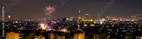 Beautiful and colorful skyline of Tehran city the capital of Iran with amazing fire works in the sky.