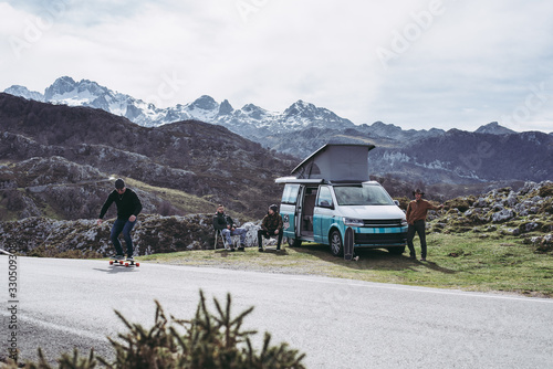 Fotografie, Tablou Campervan with friends skating in the mountains having fun open plan summer