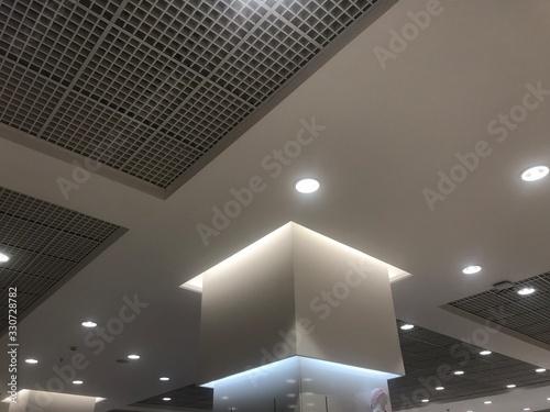 Macro Suspended Grid false ceiling with gypsum bulkhead design and column coves Fototapeta