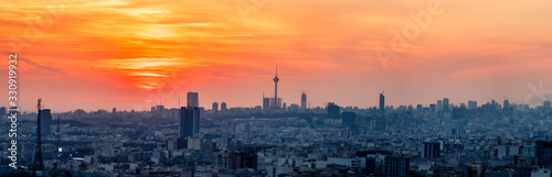 beautiful sunset over Tehran-Iran skyline at an amazing afternoon with unique clouds in the sky.