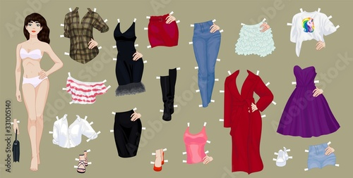 Fotografiet Paper doll of a pretty brunette girl with a variety of paper clothes and shoes
