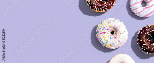 Canvastavla Collection of delicious donuts overhead view flat lay