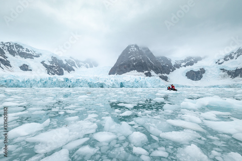 Fotografie, Obraz iceberg in antarctica south pole sea with zodiac boat