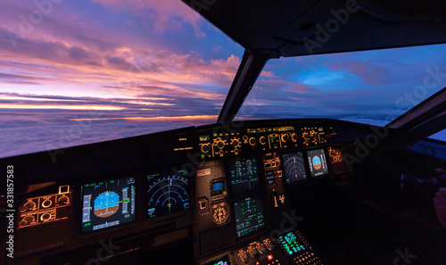 Tablou Canvas Sunset in the flightdeck of the Airbus A320