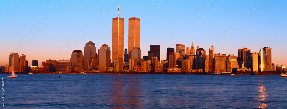 Panoramic view of lower Manhattan and Hudson River, New York City skyline, NY with World Trade Towers at sunset
