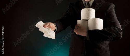 Fotografia Rich Businessman paying in Toilet Paper, copy space