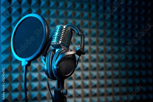 Retro microphone and pop filter on acoustic foam panel background Fototapeta