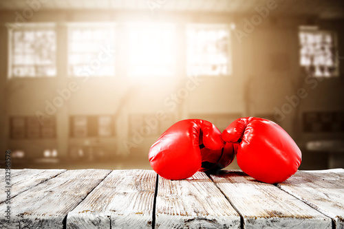Photo Red boxing gloves on desk and free space for your decoration.