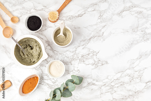 Homemade clay facial mask. Zero waste eco friendly diy beauty products ingredients on light background, flat lay