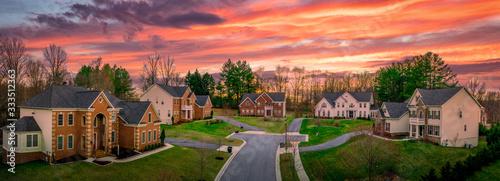 Fotografia Neighborhood street sunset panorama of modern upper middle class single family h