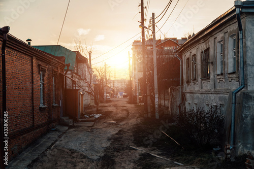 Old houses on low-rise street in old poverty part of Voronezh city in Russia in sunset