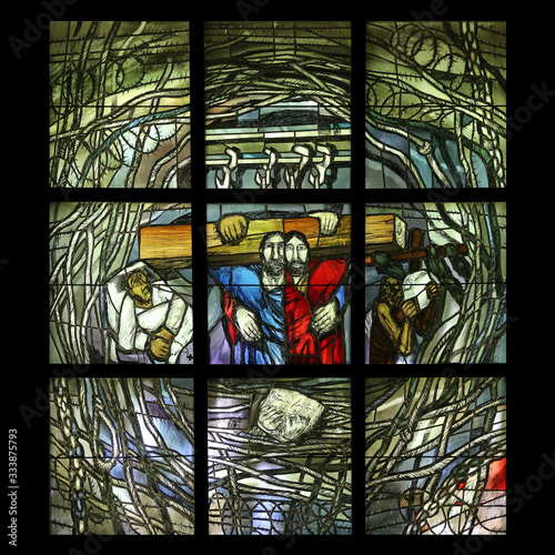 Obraz na plátne Simon of Cyrene carries the cross, stained glass window by Sieger Koder in Chape