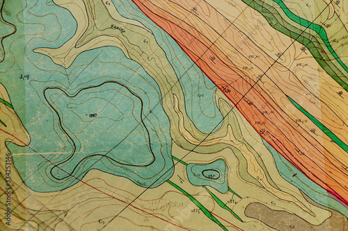 Fotografiet geological map as a background close-up in green colors