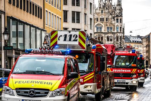 Obraz na płótnie Munich, Germany - February 11: typical german fire trucks and police car in Muni