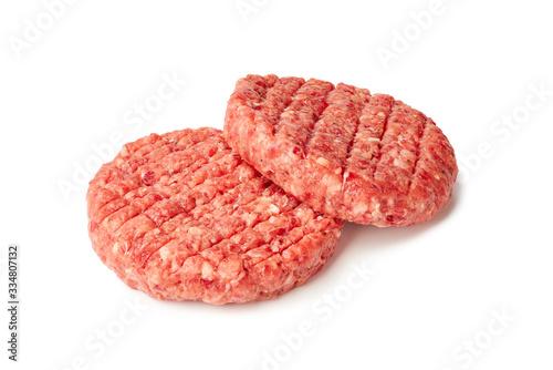 Canvastavla Two raw burger patties on white