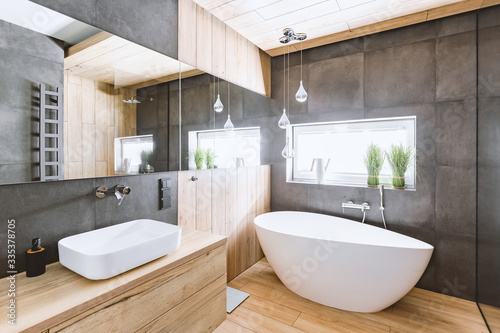 Stylish bathroom with wooden and concrete walls and white bath Poster Mural XXL