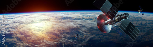 Foto Space satellite with antenna and solar panels in space against the background of the earth