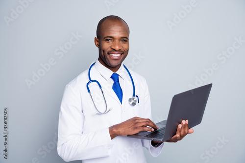 Fotografie, Tablou Photo of family doc dark skin guy hold notebook online consultation video skype