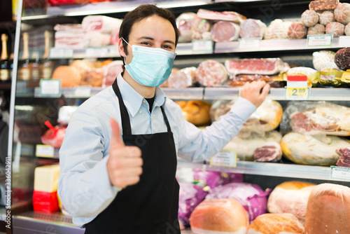 Canvas Print Shopkeeper wearing a mask