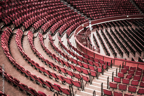 Empty red velvet seats of London west end theatre venue Fototapet