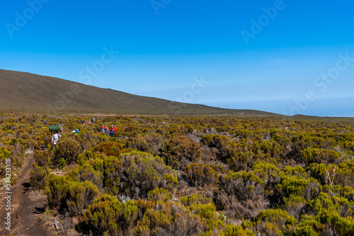 Fotografie, Obraz Camping on mount Kilimanjaro in tents to see the glaciers in Tanzania, Africa