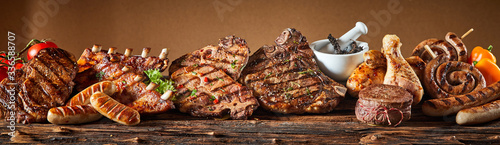 Fotografija Selection of grilled gourmet meats on timber