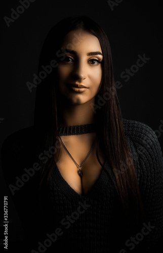 Studio portrait of a young beautiful girl of twenty years old, in warm colors of Fototapet