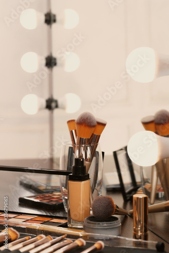 Fotografie, Tablou Decorative cosmetics and tools on dressing table in makeup room, close up