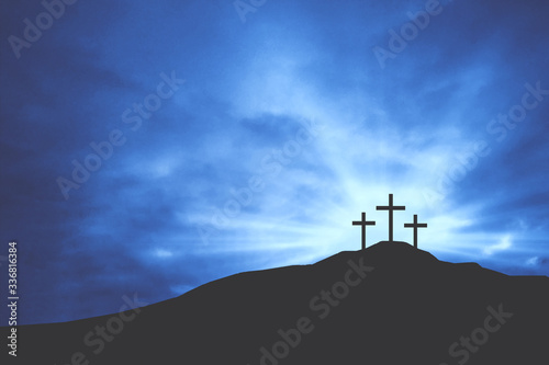 Leinwand Poster Three Christian Easter Crosses on Hill of Calvary with Blue Clouds in Sky and Co