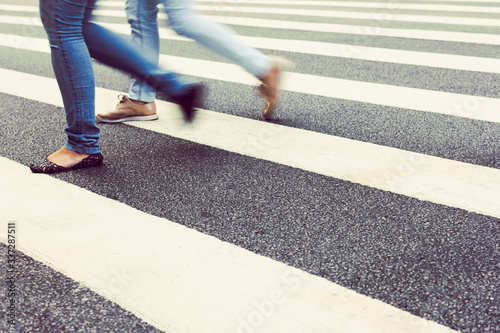 Leinwand Poster Low Section Of Woman Walking On Zebra Crossing