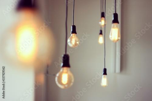 Close-up Of Illuminated Light Bulbs Hanging At Home Fototapet