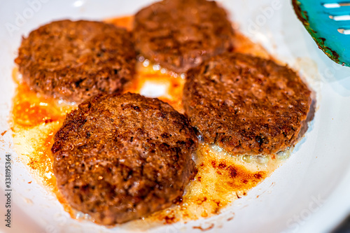 Canvastavla Vegan burgers plant-based patties cooking on ceramic frying pan macro closeup sh