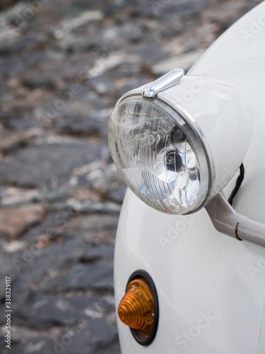 Canvastavla Close-up shot of a headlight of a Citroen 2CV car